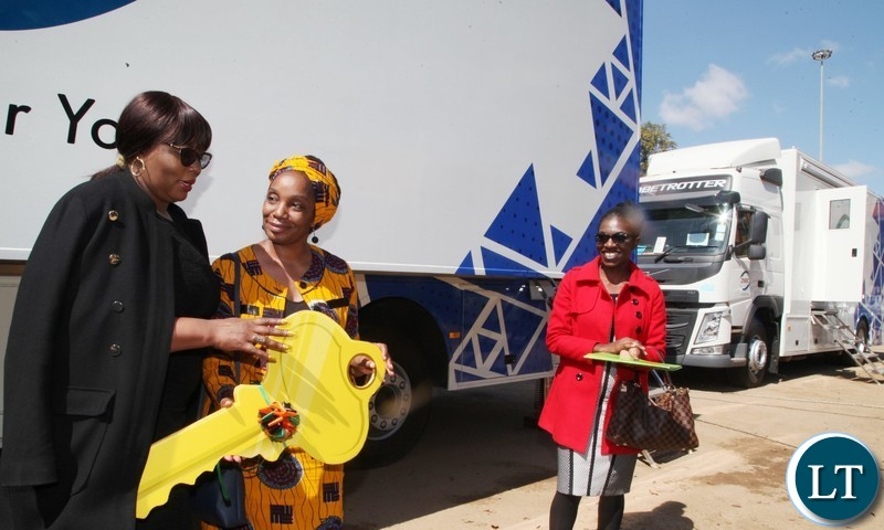 INFORMATION Minister Dora Siliya hands over a dummy key for the Outside- Broadcasting Trucks to ZNBC board chairperson Mulenga Kapwepwe during handover