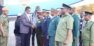President Edgar Lungu being welcomed by Zambia Air Force commandant Lt.Gen. Eric Chimese shortly after his arrival from Chipata at Lusaka City airport