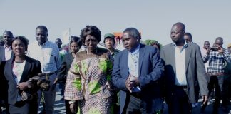 Vice President Inonge Wina (L) paying attention to Mongu District Administrative Officer Fredrick Inambao Lubasi (R) upon arrival at Mongu Airport for ground breaking ceremony of a Modern Clinic in Lealui Ward and Inspect progress on the Cashew Infrastructure Development Project (CIDP) in Western Province.