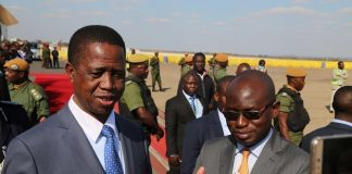 President Edgar Lungu flanked by Special Assistant to President for Press and Public Relation Amos Chanda speaking to Journalists shortly before his departure for South Africa at Kenneth Kaunda International Airport