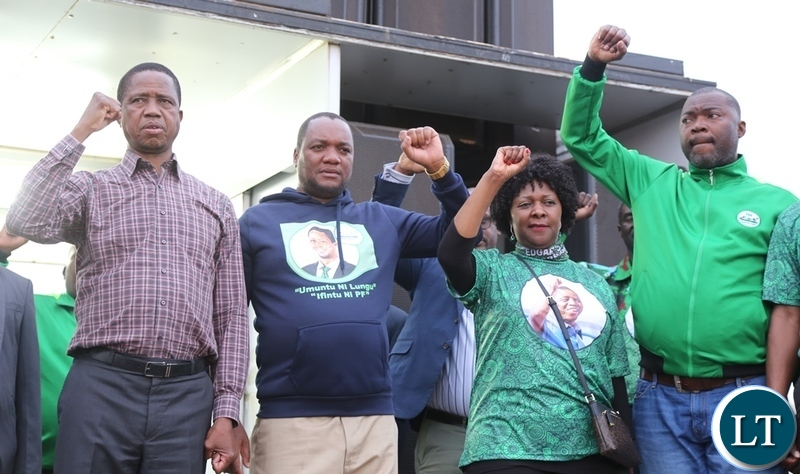 President Edgar Lungu, Lusaka Mayoral Candidate Miles Sampa Finance Minister Margrate Mwanakatwe and Lusaka Province Minister Bowman Lusamba shows part symbol during really in Bauleni