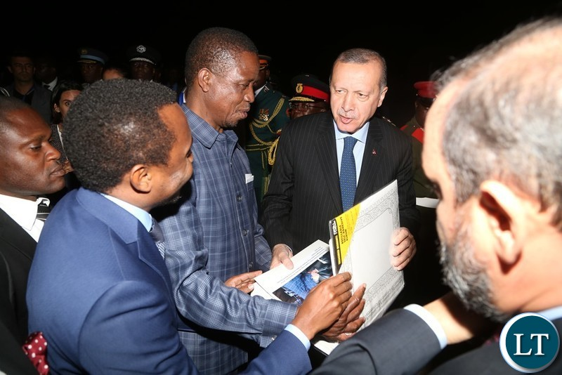 President Edgar Lungu and President of Turkey Recep Erdogan going through the photo album shortly before his departure at Kenneth Kaunda International Airport