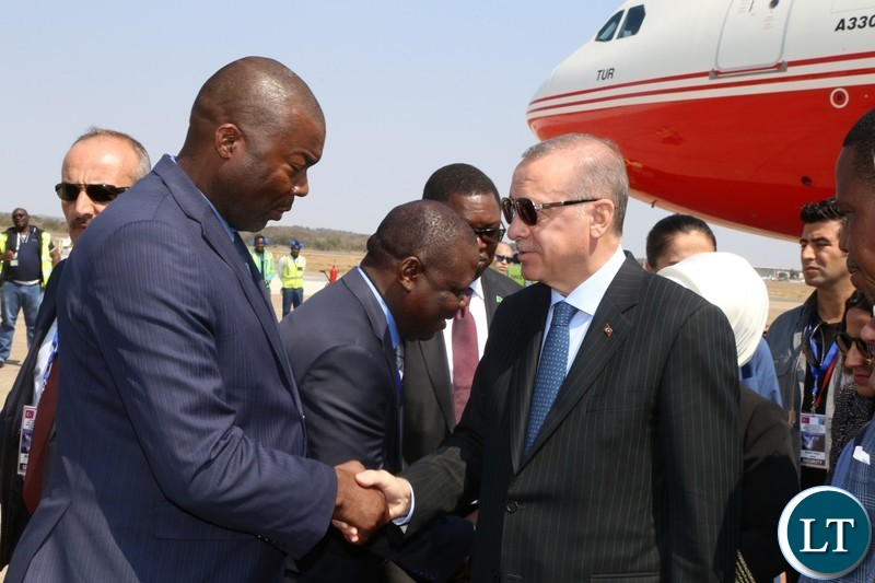 Recep Tayyip Erdogan President of The Republic of Turkey walk abreast with His Excellency President Edgar Chagwa Lungu on arrival at Kenneth Kaunda International Airport