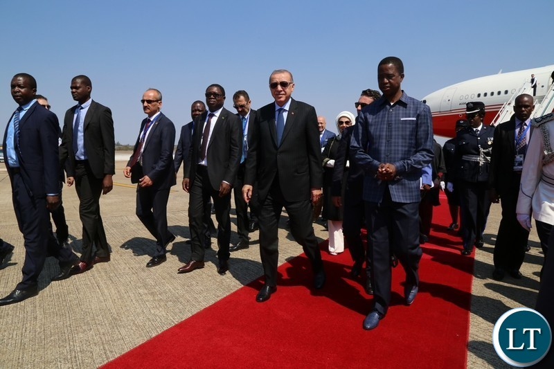 Recep Tayyip Erdogan President of the Republic of Turkey, inspects a guard of honor on arrival at Kenneth Kaunda International Airport.