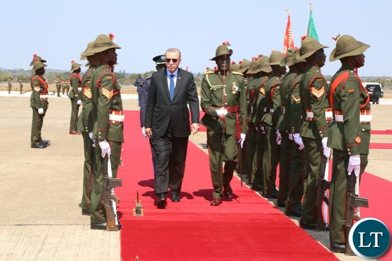Recep Tayyip Erdogan greets Turkish officials on arrival at Kenneth Kaunda International Airport