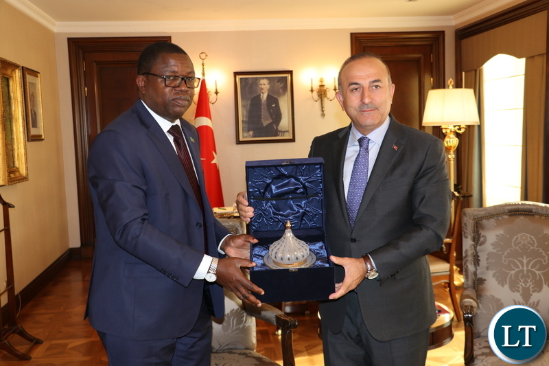 Minister of Foreign Affairs Joseph Malanji presents a gift to his Turkish counterpart Mevlut Cavusoglu at the Ministry of Foreign Affairs of the Republic of Turkey headquarters in Ankara