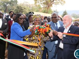 First Lady Esther Lungu cuts a ribbon with IIROSA Regional Director -Southern Africa Sheikh Walid R. EL Saadi and Health Minister Dr Chitalu Chilufya during the Commissioning of the eye hospital at Chipata Central Hospital, where she also launched an eye camp set by the Esther Lungu Foundation Trust in partnership with the International Islamic Relief Organization for Southern Africa (IIROSA) and the Ministry of Health on Tuesday, July 10,2018 -Picture by THOMAS NSAMA