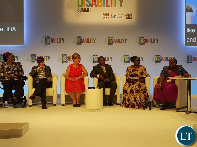 Hon.Kabanshi addressing the summit at the Global Disability meeting that was held in London