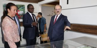 Turkish Cooperation and Coordination Agency (TIKA) President, Dr Serdar Cam shows a miniature building of a school project undertaken by TIKA to Minister of Foreign Affairs , Joseph Malanji in Ankara yesterday-Picture by JERRY MUNTHALI