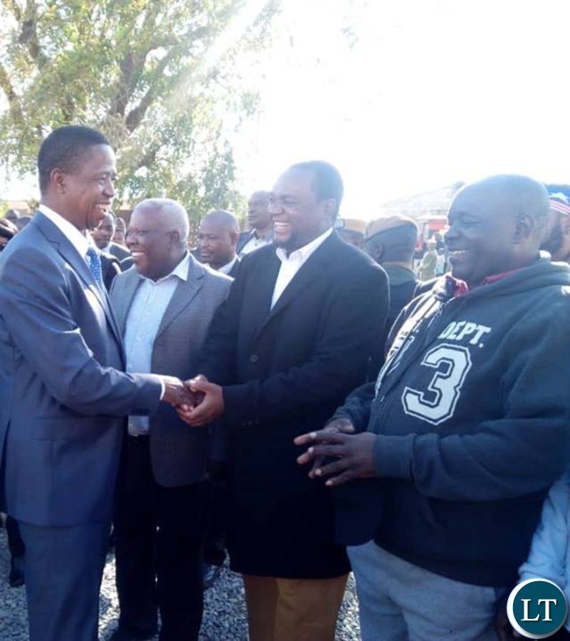 PF Lusaka Mayor aspiring candidate Miles Sampa welcoming President Lungu at Andrew Mwenya Polling station in Chawama this morning