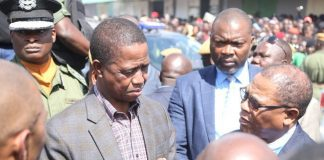 President Edgar Lungu talks to COMESA Secretary General Songiso Ngwenya during the tour of gutted COMESA market