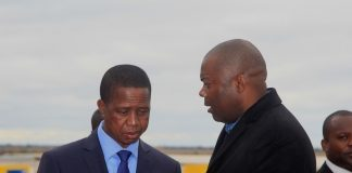 President Edgar Lungu confers with Lusaka Province Minister Bowman Lusambo before departure for Turkey at Kenneth Kaunda International Airport