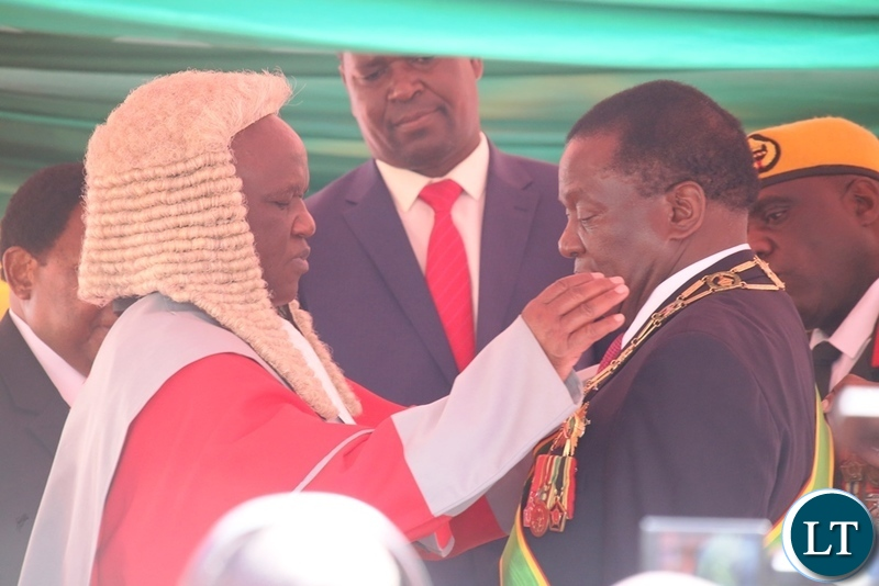 President Emmerson Mnangagwa being given the instrument of power by Chief Justice Luke Malaba for his inauguration ceremony