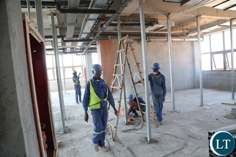 China Jiangxi workers; working on the final touches on the 82% New Passenger Terminal at Kenneth Kaunda International (KKIA) the facility costing $360 million