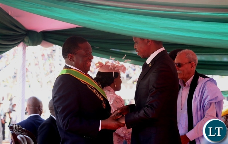 President Edgar Lungu congratulates President Emmerson Mnangagwa during his inauguration ceremony