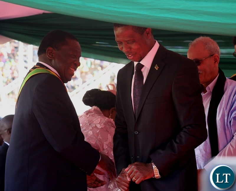 President Edgar Lungu having a light moment with President Emmerson Mnangagwa shortly after congratulates him at his inauguration ceremony y