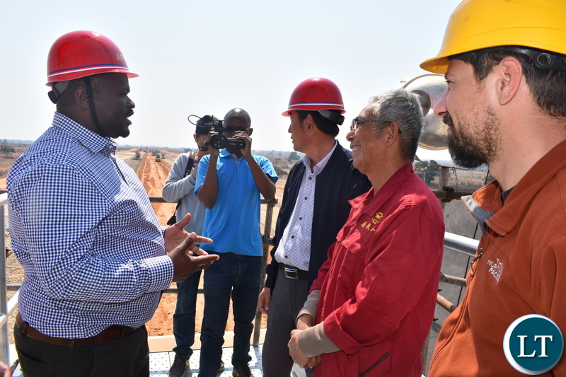 Minister of National Development Planning Hon. Alexander Chiteme (left) talking to AFECC Contract Manager Jia Tao Kan, Jack Tao and resident engineer Alex Karampis at the Mwomboshi Dam in Chibombo District on Thursday 2 August 2018. Photo | Chibaula D. Silwamba | MNDP
