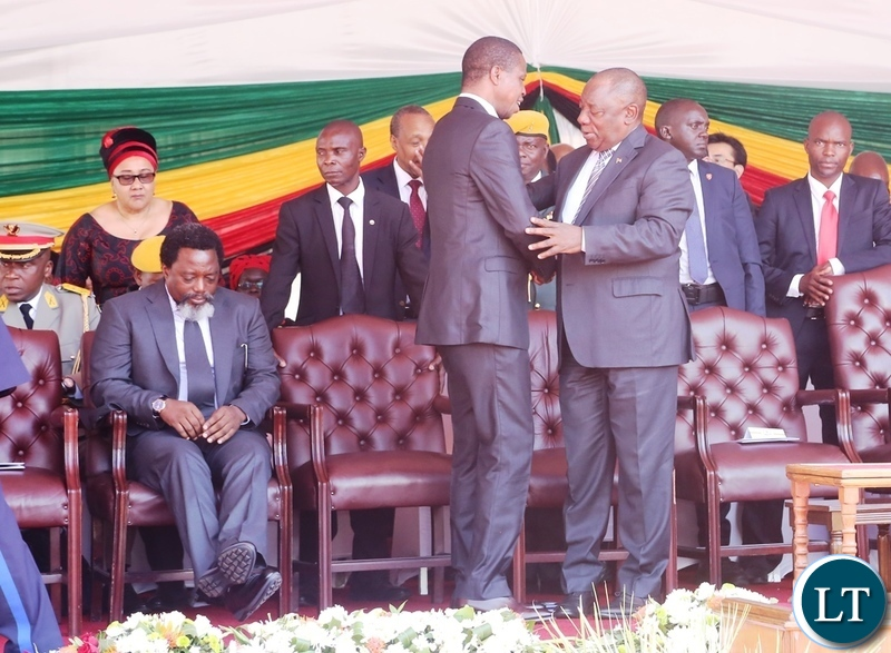 President Edgar Lungu confers with South African President Ramaposa whilst AU Chairperson who is also President of Rwanda Paul Kagami listens during President Emmerson Mnangagwa inauguration ceremony