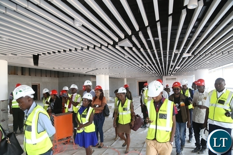 Lusaka based Journalists touring the 82% New Passenger Terminal at Kenneth Kaunda International (KKIA) during the tour of the facility costing $360 million