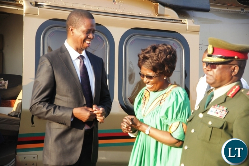 President Edgar Lungu talking to Vice President Inonge Wina before departure for Zimbabwe at Kenneth Kaunda International Airport
