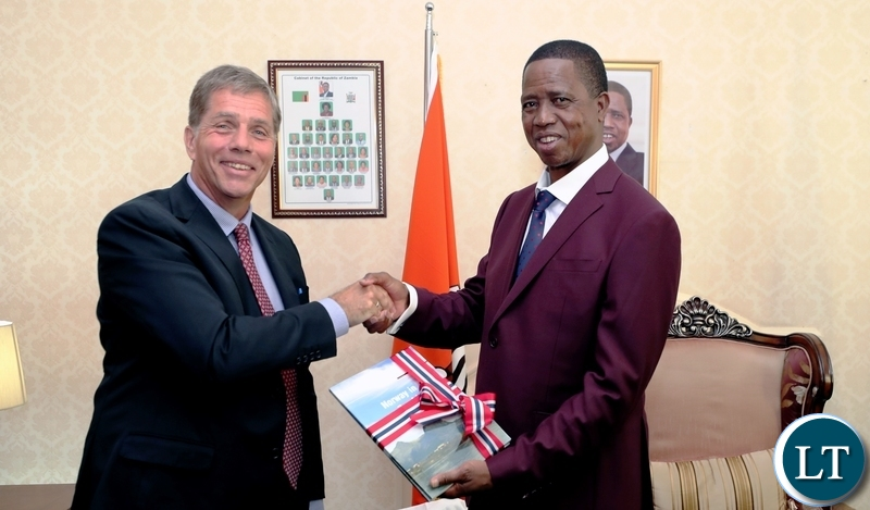 President Edgar Chagwa Lungu (right) receives a book on Norway's development activities in Zambia from Norwegian Ambassador to Zambia Kikkan Haugen when he paid a farewell courtesy call on the President at State House on Wednesday, August 1,2018 . PICTURE BY EDDIE MWANZALEZA/STATE HOUSE ©2018