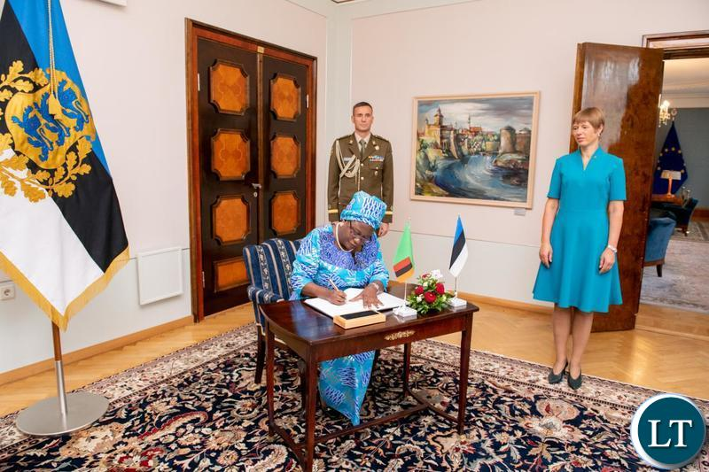 Zambia's Ambassador Extra-ordinary and Plenipotentiary to Estonia, Her Excellency Rose Salukatula signs the Credentials Book soon after presenting her Letters of Credence to Estonian President Her Excellency Kersti Kaljulaid in Tallin. Looking on is President Kaljulaid.