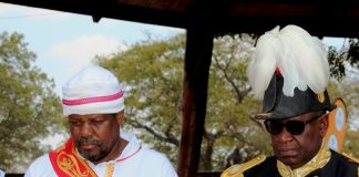 PARAMOUNT Chiefs Gawa Undi of the Chewa ( in white) and his guest, Litunga, Lubosi Imwiko the second, of the Lozi people in Western Province, at this year's Kulamba traditional ceremony of the Chewa held at Mkaika in Katete on Saturday. PICTURE BY STEPHEN MUKOBEKO/ZANIS