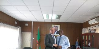 MINISTER of Works and Supply FELIX MUTATI in a jovial mood with U S Ambassador to Zambia Mr. DANIEL FOOTE after a fruitful discussions at the Minstry Headquarters after a courtesy call. Picture By NDUBI MVULA.
