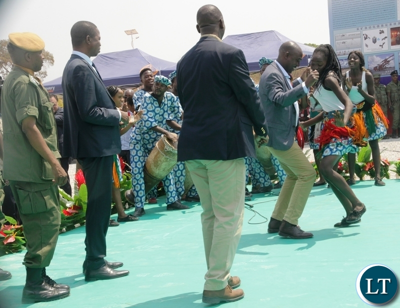 President Edgar Lungu looking at Copperbelt Province Minister Japhen Mwakalombe dance during the commissioning of NFCA mining project in Chambishi