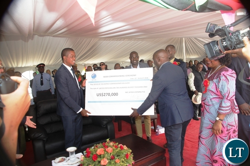 President Edgar Lungu receives a cheque on behalf of Kalulushi Constituency from NFCA during the commissioning of NFCA mining project in Chambishi