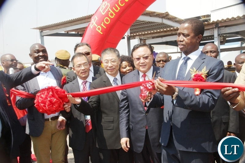President Edgar Lungu cutting the ribbon to officially commission the NFCA mining project in Chambishi