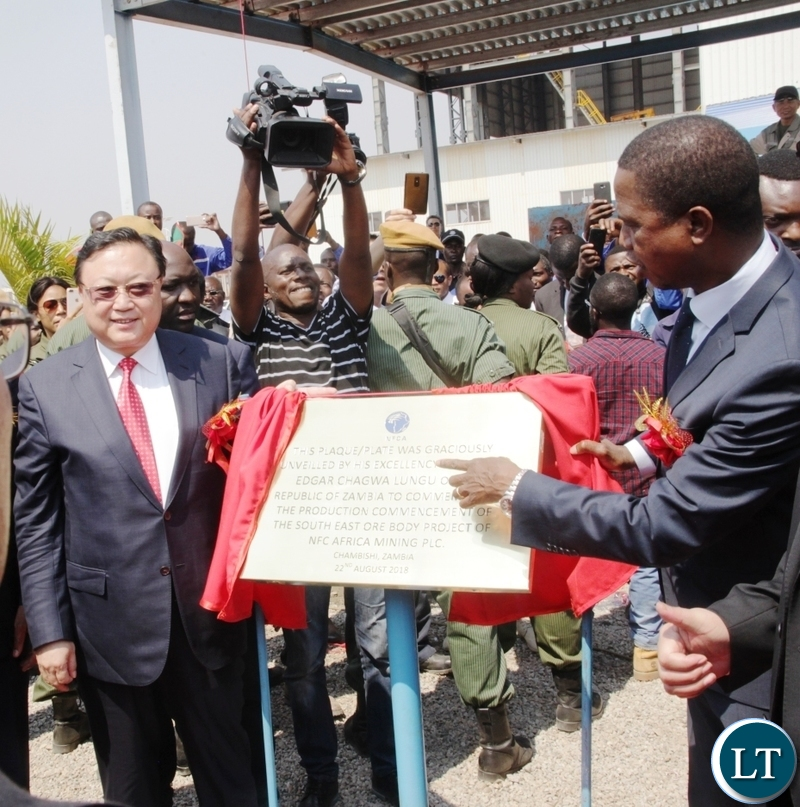 President Edgar Lungu reading words on the plaque after officially commission the NFCA mining project in Chambishi