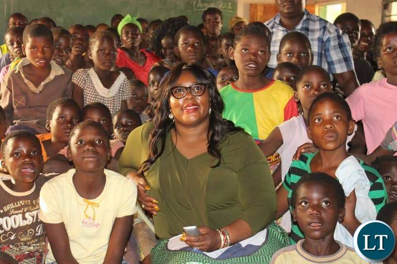 nformation and Broadcasting Services Minister who is also Chief Government Spokesperson & Petauke Member of Parliament Hon Dora Siliya MCC with kids at Chimunsi Primary School after the launch of the Satellite Village Television in Sinda District
