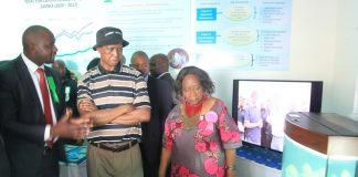 President Edgar Lungu listens to Lizzen Moono Monitoring and Evaluation specialist at the Ministry of Fisheries and livestock during the tour of stands at the 92nd Agriculture and Commercial Show of Zambia