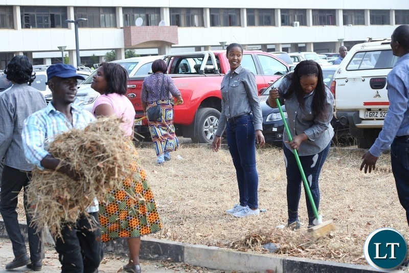 Ministry of Information Staffs joining in the keep Zambia Clean, Green and Healthy Campaign cleaning at Government Complex