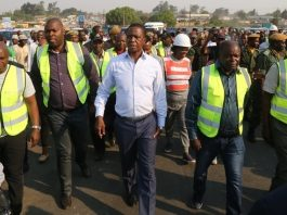 President Edgar Lungu flanked by Minister of Infrastructure Ronald Chitotela (2nr) RDA Chief Executive Officer Eng. Elias Mwape (r) Lusaka Province Minister Bowman Lusambo (2nl) and Special Assistant to the President Andrew Chellah (l) inspecting the progress on Lumumba roads