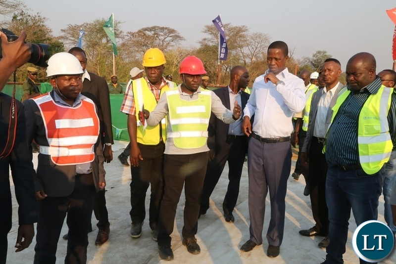 RDA Eng. Derrick Mwenefumbo explains on the progress on ngwerere bridge to President Edgar Lungu during the tour of the bridge by the President
