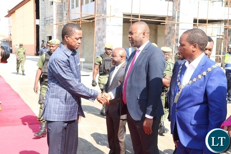 President Edgar Lungu greets Lusaka Province Minister Bowman Lusambo who is flanked by Lusaka mayor Miles Sampa  shortly before his departure to Livingstone at Lusaka City Airport