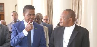 President Edgar Lungu confers with Vice Chair of the Conference of Catholic Bishops of Democratic Republic of Congo Bishop Fridolin Ambongo shortly meeting the President at State House