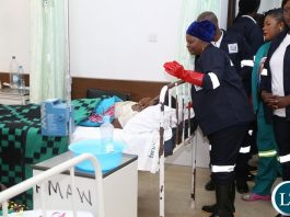 First Lady Esther Lungu cleaning at University Teaching Hospital (UTH) emergency ward during the keep Zambia Clean, Green and Healthy Campaign