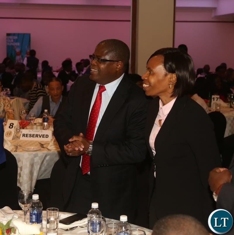 Minister of Commerce Christopher Yaluma and Permanent Secretary Kayula Siame having a light moment during World Export Development Forum Gala Dinner at Pamodzi Hotel