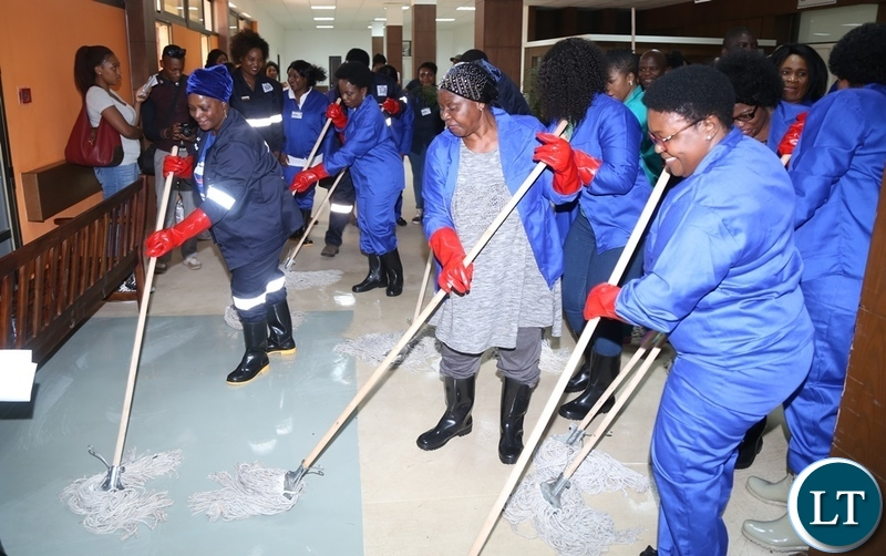 First Lady Esther Lungu with Ministers spouses cleaning at University Teaching Hospital (UTH) emergency ward during the keep Zambia Clean, Green and Healthy Campaign