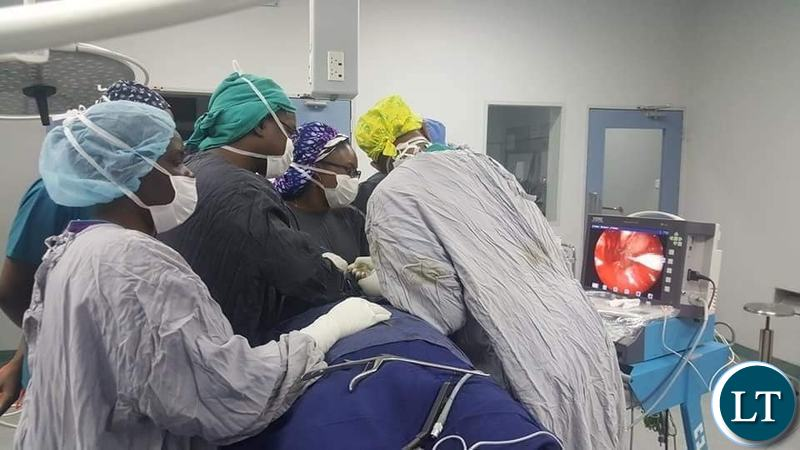 UTH  team of Neurosurgeons and ENT surgeons in the operating theatre
