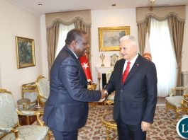 Zambia's Ambassador to the Republic of Turkey, Dr Joseph Chilengi presents a gift to Speaker of the Grand National Assembly of the Republic of Turkey, Binali Yildirim in Ankara