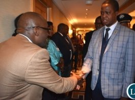 """Ministry of National Development Planning Permanent Secretary Mushuma Mulenga (brown jacket) welcoming His Excellency Mr. Edgar Chagwa Lungu, President of Zambia, at New York Palace Hotel in New York, USA on Sunday 23 September 2018. President Lungu and his delegation are in New York to participate in the 73rd UN General Assembly High-Level Segment. The theme of the General Assembly is: """"Making the United Nations relevant to All people: Global leadership and shared responsibilities for peaceful, equitable and sustainable societies."""" Photos 