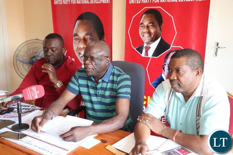 UPND Secretary General Stephen Katuka addressing a media briefing today flanked by Mazabuka Central MP Garry Nkombo and Deputy National Secretary Patrick Mucheleka.