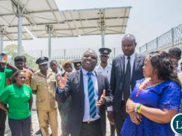Zamtel CEO Sydney Mupeta explains the technical specifications of the new tower to Ngabwe Council Chairperson Tshili Mizinga during the commissioning of the tower in Ngabwe on Wednesday