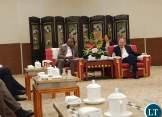 Lusaka Province Minister Bowman Lusambo confers with the Governor of Sichuan Province of China Mr. Yin Li at the 3rd Western China Public Procurement Conference during the 17th Western China International Fair being held in Chengdu, Sichuan Province China.