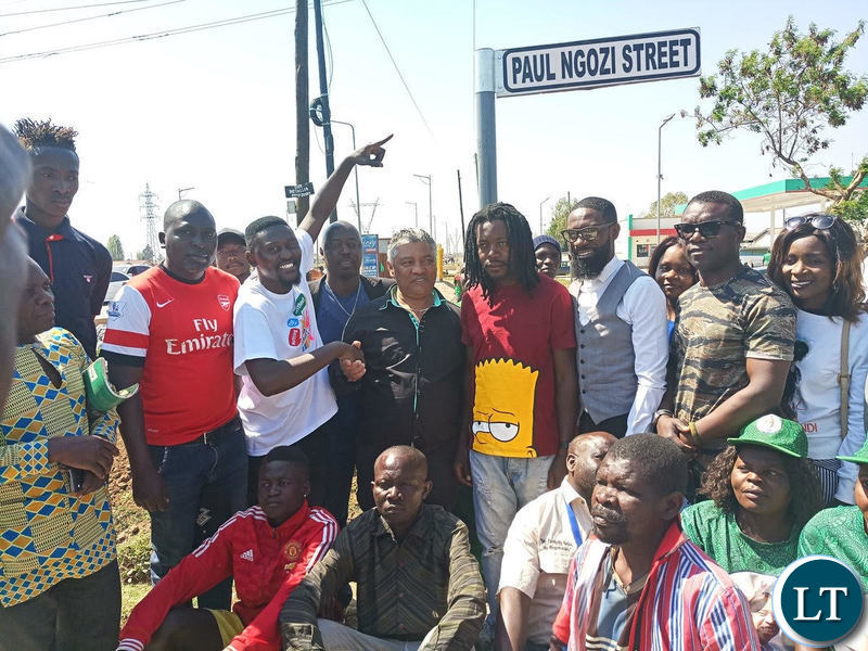 Kabwata MP Given Lubinda unveils the Paul Ngozi streets flanked by Paul Ngozi Jr In red T-shirt) and musicians