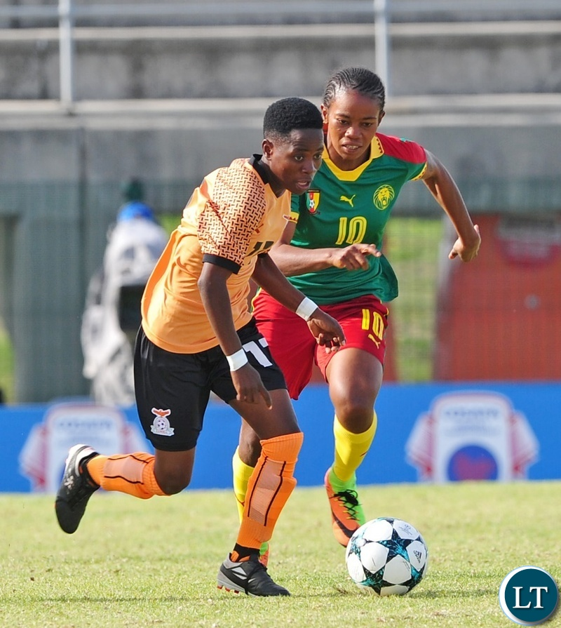 Mary Mwakapila of Zambia takes on Charlene Yverna Meyong Menene of Cameroon during the 2018 Cosafa Womens Championship game between Zambia and Cameroon at Wolfson Stadium in Port Elizabeth on 15 September 2018 © Ryan Wilkisky/BackpagePix